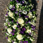 Casket spray purple and white